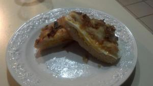 Caramelized onion and rosemary focaccia bread with egg and cheese.